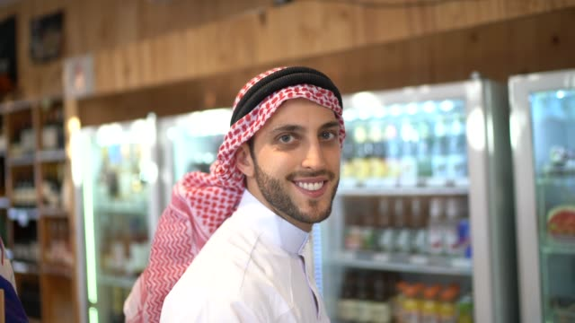 Portrait of Arab Middle East man buying at refrigerated section